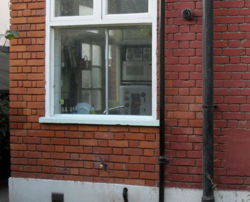 Paint removal and brickwork restoration