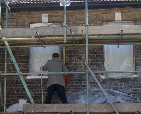 Man cleaning brickwork