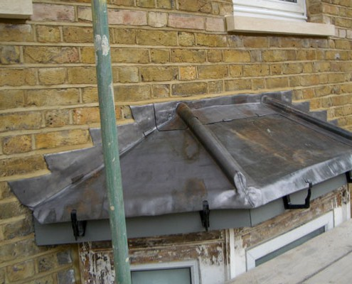 Replace defective lead bay roof