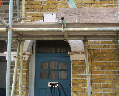 Paint removed from archway brick work and stone work