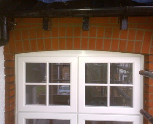 Window arch and surrounding brickwork repointed