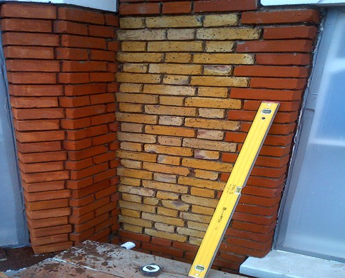 Brickwork rebuilt to match existing